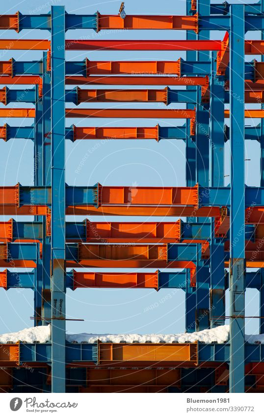 Building metal structure joists pattern with snow-Vertical shot architecture building construction iron design industry industrial modern outdoor sky technology