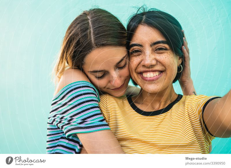 Lovely lesbian couple taking a selfie. female happy together two concept romance homosexual girl leisure hagging portrait girls picture laughing romantic pretty