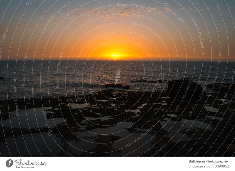 Sunset in Morocco Sunlight Vacation mood Vacation photo Water Ocean Atlantic Ocean Atlantic coast Horizon Orange Stone Evening Dusk Africa North Africa open sea