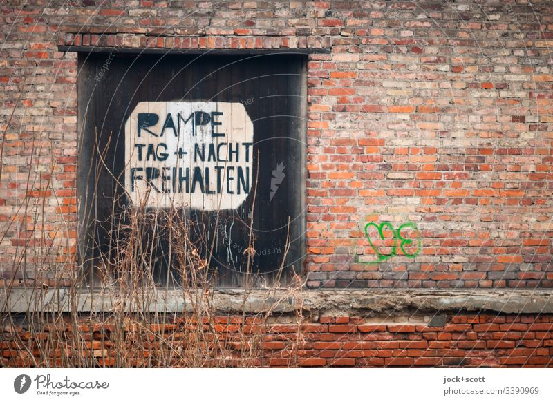 Ramp, day + night Keep clear Downtown Berlin Winter Bushes Goal Signage Brick Warning sign Old Bans Nostalgia Decline Past Transience Capital letter
