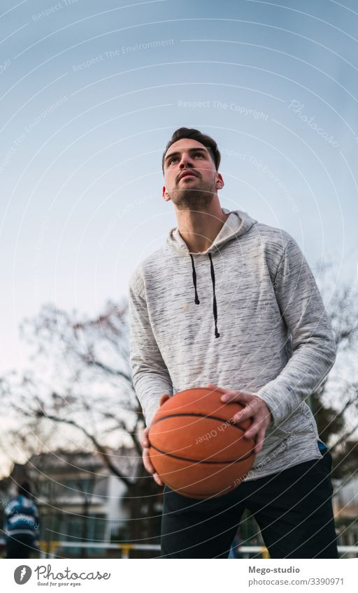 Young man playing basketball. training male young sport game player outdoor street hand athletic active boy playground club sporty workout leisure athlete fit