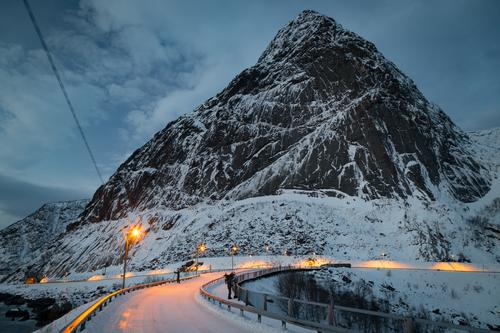 Snowy road in front of winter landscape on the Lofoten Vacation & Travel Trip Winter Winter vacation Environment Landscape Sky Clouds Bad weather Ice Frost