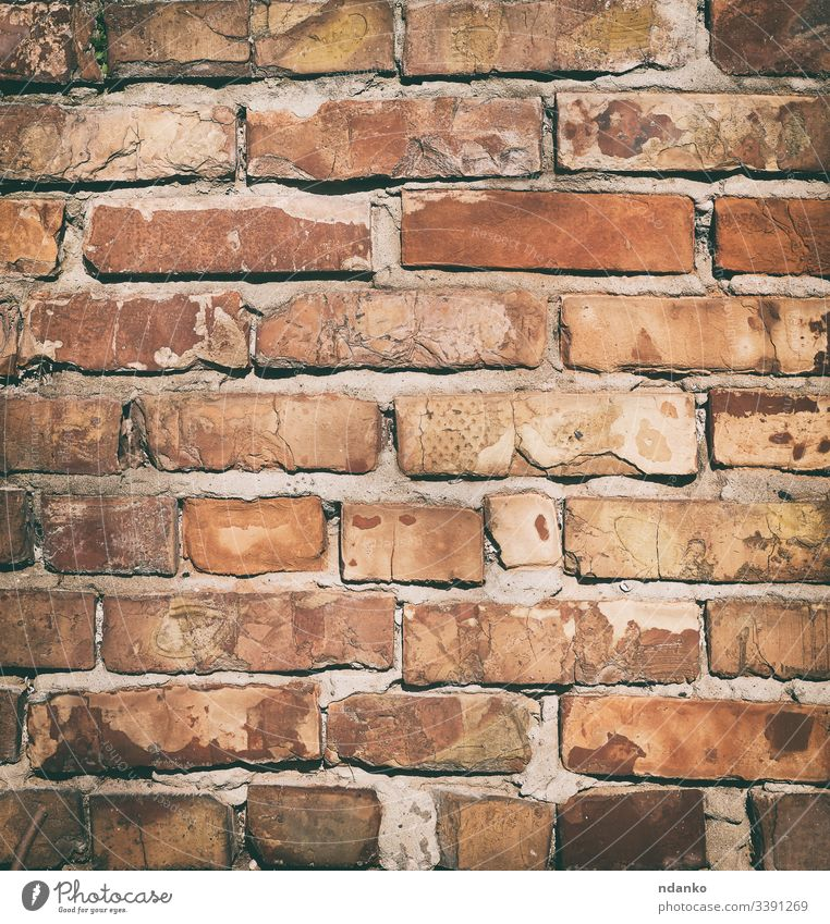 red brick wall with cement, fragment of architecture masonry old brown rectangular background rough construction material block stone building solid texture