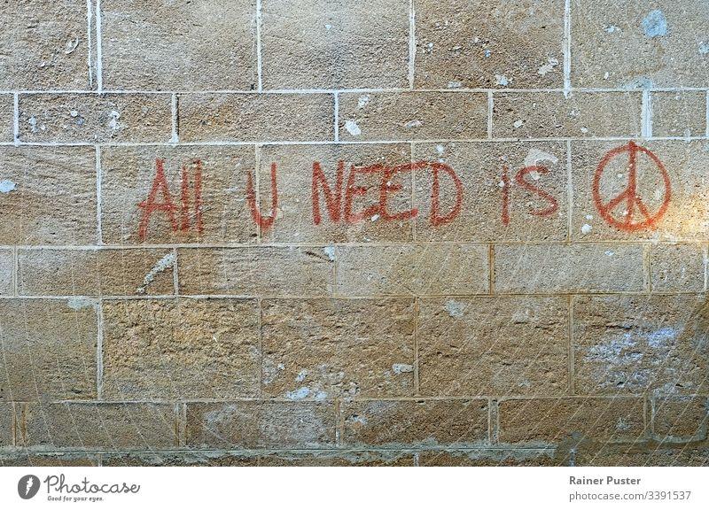Graffiti on a wall: All U Need Is Peace peace peace movement symbol street art peace sign Sign