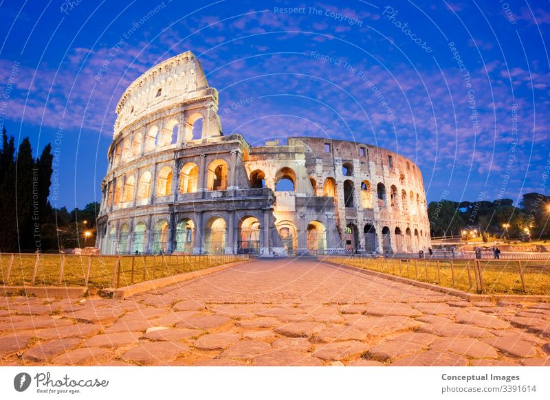 The Colosseum illuminated at dusk amphitheater ancient archeology architecture arena cityscape coliseum colosseum culture destination empire europe european