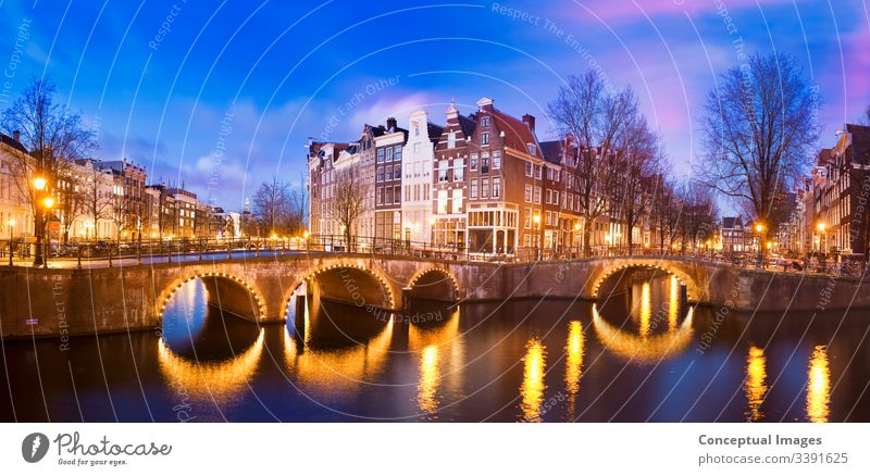 Keizersgracht Canal at dusk amsterdam architecture bridge canal capital city dutch europe evening famous holland illuminated keizersgracht canal landmark