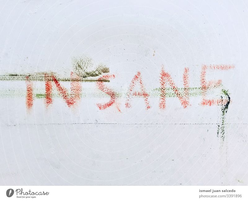 insane word painted on the dirty white wall letters words Characters Wall (building) Wall (barrier) Dirty Letters (alphabet) Word Graffiti Typography Facade Old
