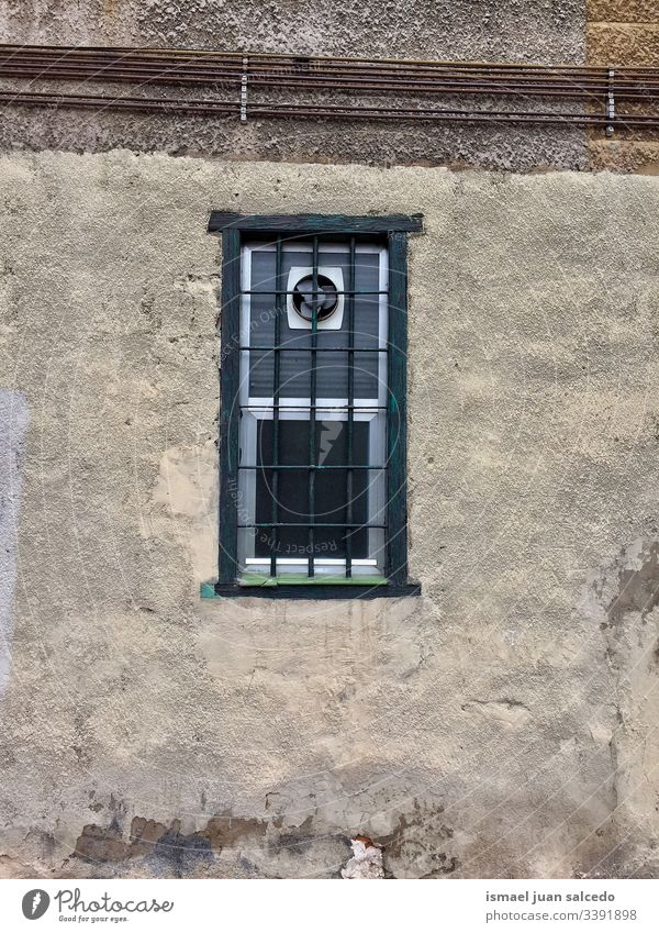 old window on the wall of the house in Bilbao city Spain facade building exterior balcony home street outdoors color colorful structure architecture