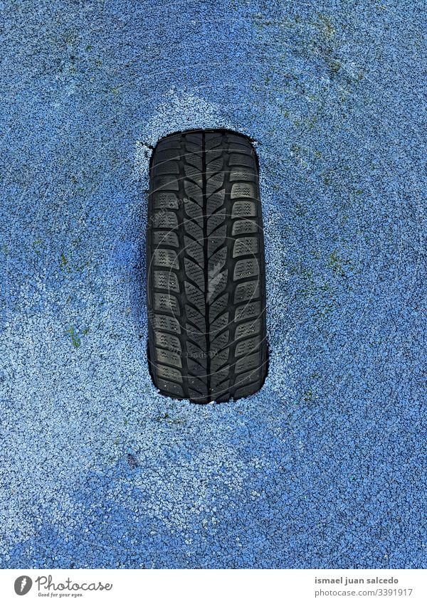 black tire on the blue ground land dirt dirty backgrounds textured Pattern Abstract Surface Rough Material Old abandoned