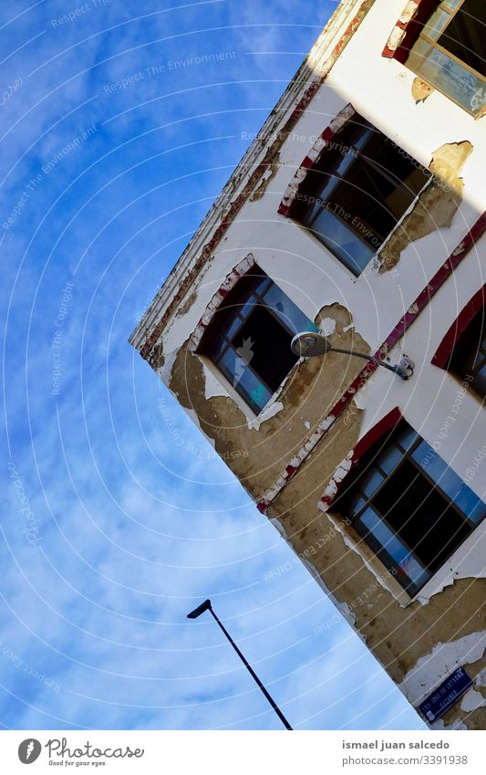 window on the old house, architecture in Bilbao city Spain white facade building exterior balcony home street outdoors color colorful structure construction