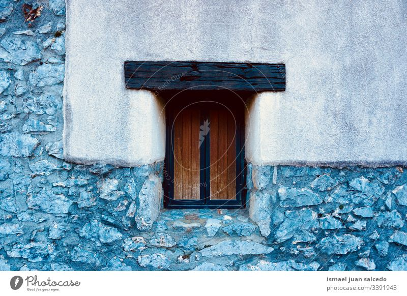 wooden window on the wall of the house white facade building exterior balcony home street city outdoors color colorful structure architecture construction