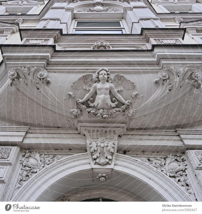 Guardian angel made of stucco above old house entrance Angel Entrance door Facade built slice Gypsum decoration Decoration Art nouveau Old ornamental