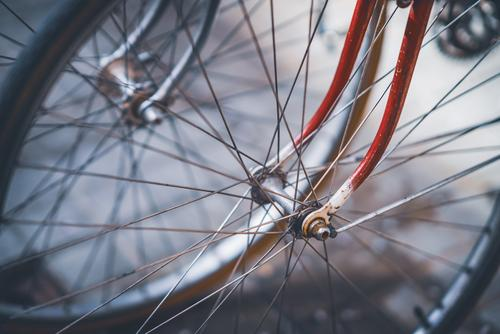 Front wheels, spokes and forks of a couple vintage bicycles color exterior outdoor outdoors front wheels nobody no people close up closeup close-up urban city