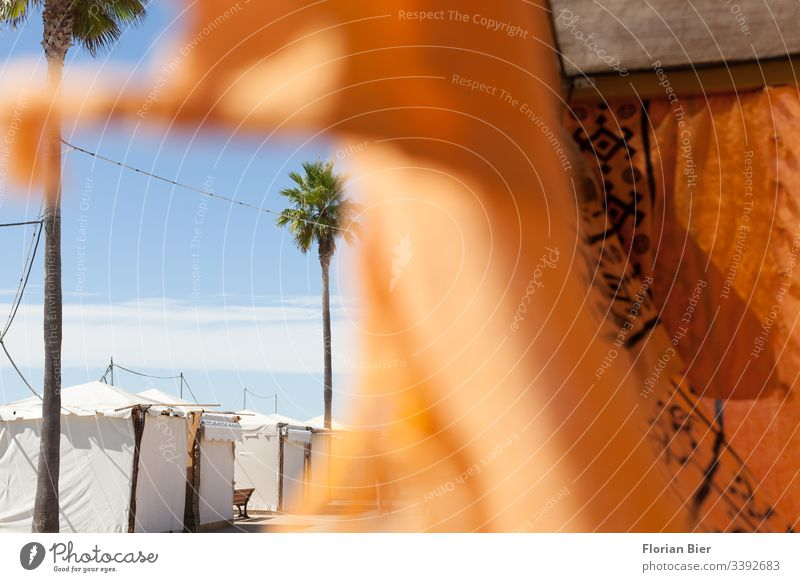 Closed market place with waving cloth on a promenade Markets stand Tent Marketplace Rag Covers (Construction) Structures and shapes Palm tree Sky concealment