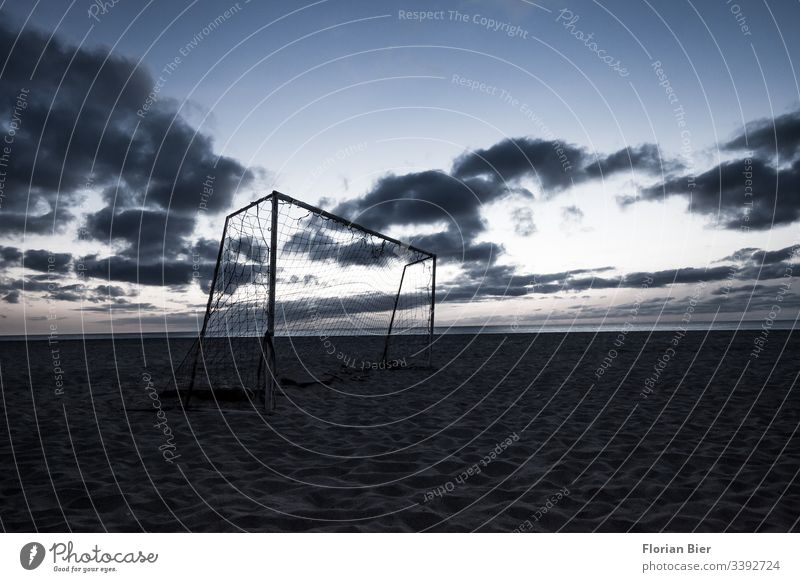 Soccer goal on the beach after sunset Deserted Exterior shot Subdued colour Colour photo Ambition Employment improvised game Africa poles winners fun free time