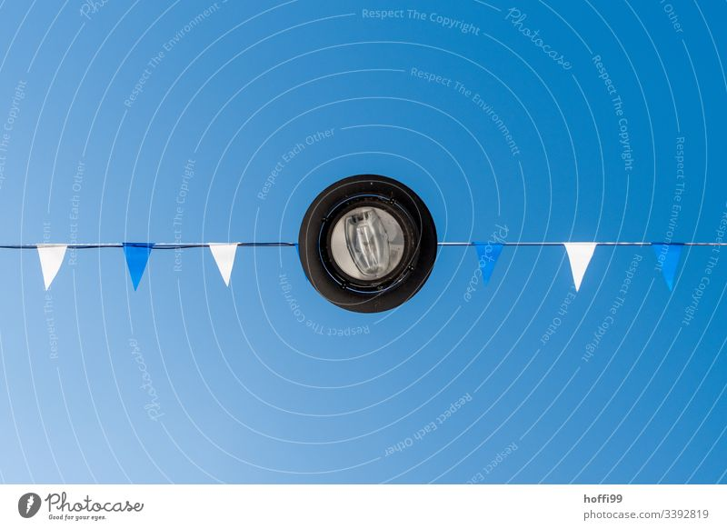 Lamp from below with white and blue flags against blue sky Lantern light Flag Street lighting Minimalistic Blue sky Blue background Summer Exterior shot