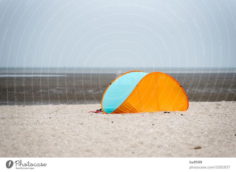 closed beach shell / tent at the sandy beach wind deflector Tent Ocean Beach Island Tourism Vacation & Travel Relaxation North Sea vacation Coast Sand beach toy