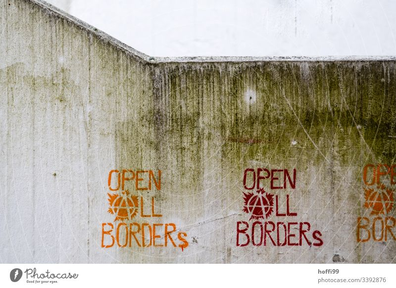 Demand Message Statement - Opens all borders Illustration graffiti open all borders Politics and state political expression Remark Concrete wall Dirty Gray Red
