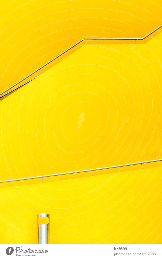yellow staircase with railing and waste bin made of stainless steel Yellow yellow wall High-grade steel Nikon yellow architectural photography