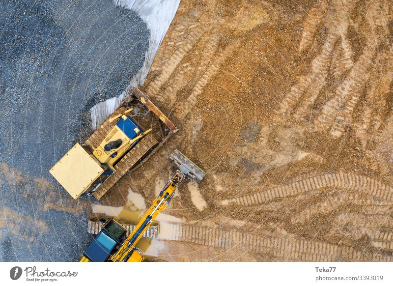 construction vehicle on an construction site from above excavator excavator from above Caterpillar Caterpillar from above modenr Caterpillar yellow mud water
