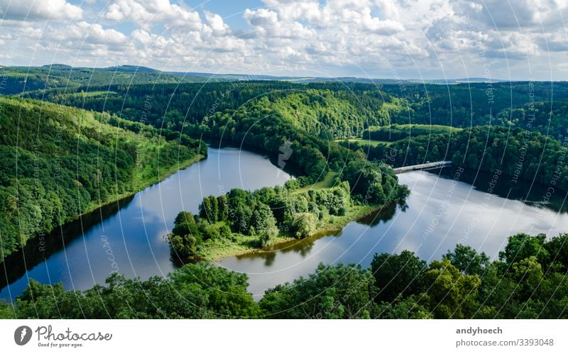 headland with a river and a dam above aerial Background beautiful beauty blue clouds course day edge flow flowing foresight forest forrest germany grass green