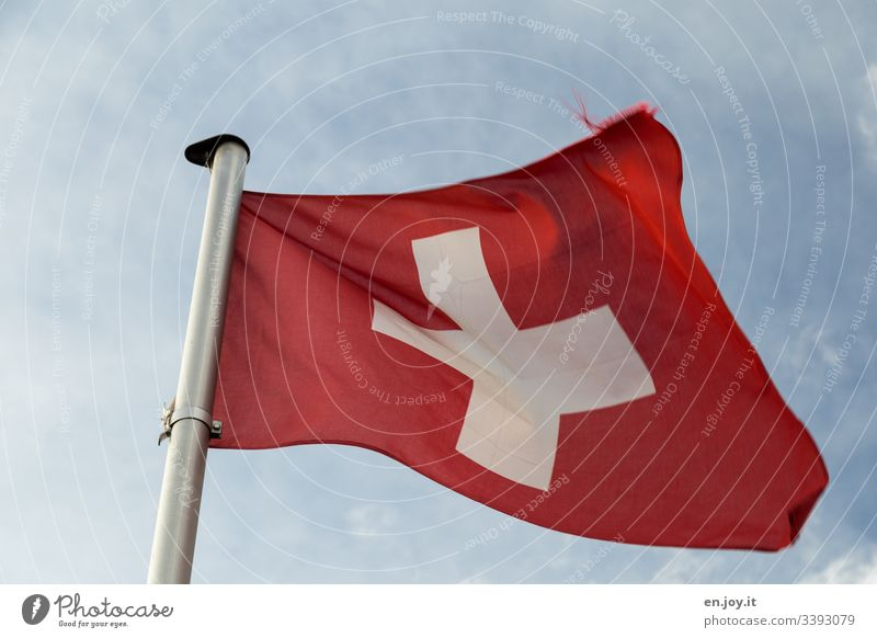 Swiss flag in front of cloudy sky Sky Clouds Flag Switzerland Red Crucifix White Blow Pole Flagpole Wind