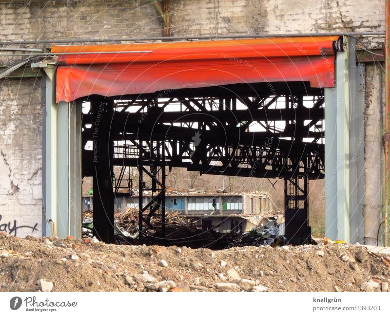 Industrial ruin with large gate with red tarpaulin Industrial wasteland Deserted Industrial plant Old Exterior shot Decline Colour photo Factory Day Building