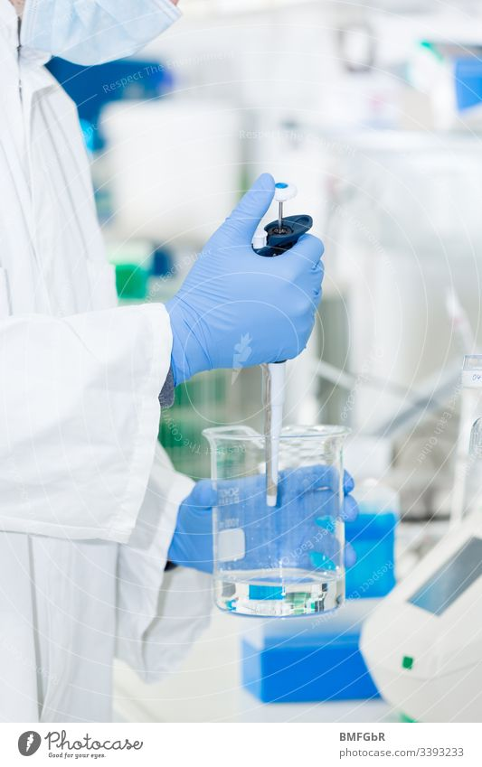 Person in the laboratory with face mask and gloves works with liquid person Mask Gloves Fluid Health care Hospital Doctor Surgeon Healthy Medication
