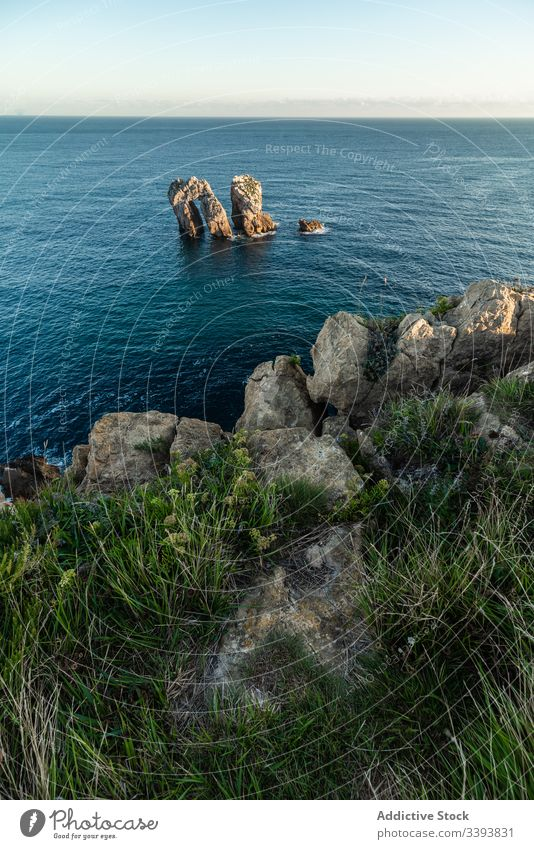 Peaceful landscape of rocky cove in sunset scenery peaceful sea skyline coastline nature water destination tourism seascape cliff stone holiday summer vacation