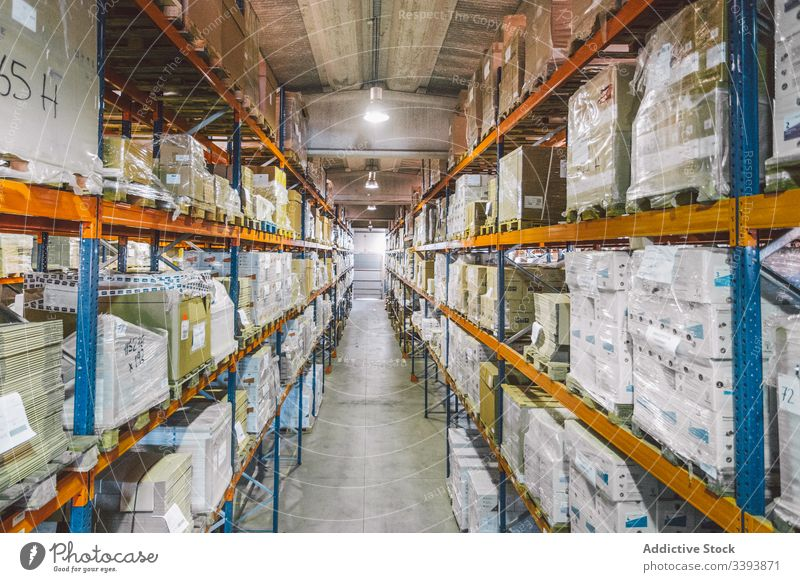 Storage with lot of boxes warehouse storage package logistic container shelf passage empty industry facility service cargo contemporary construction job modern