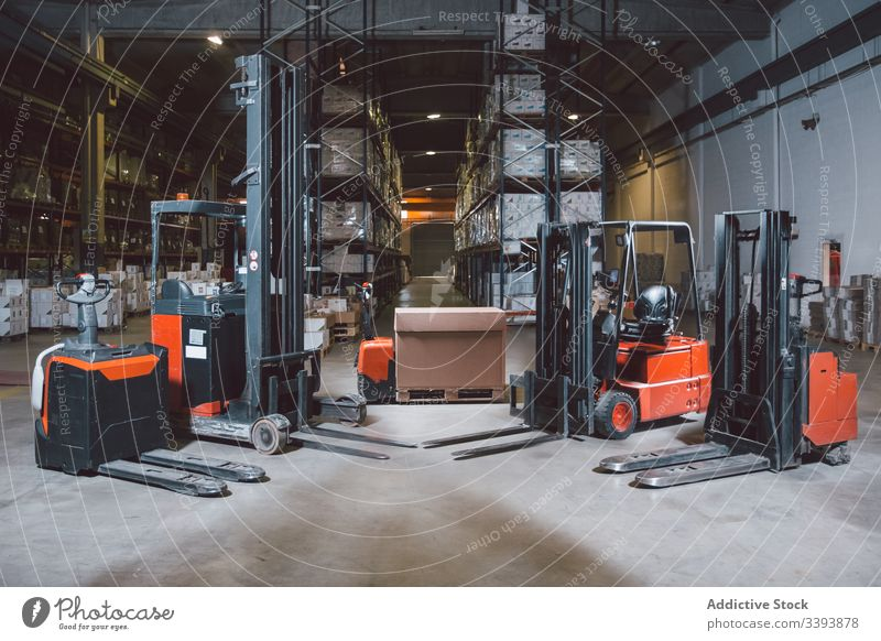 Modern equipment in big warehouse forklift truck storage machine shipment modern service logistic production cargo package automatic process appliance commerce