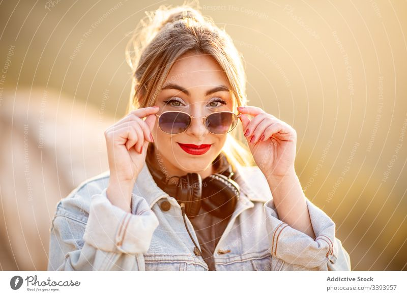 Stylish woman in casual wear delighting in view smile enjoy sun style trendy lifestyle harmony fashion rest relax outfit weekend contemporary young idyllic calm