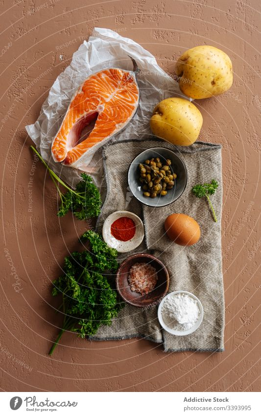 Ingredients for recipe with fish and vegetables ingredient food salmon cooking healthy potato spices steak parsley kitchen meal dinner lunch seafood preparation