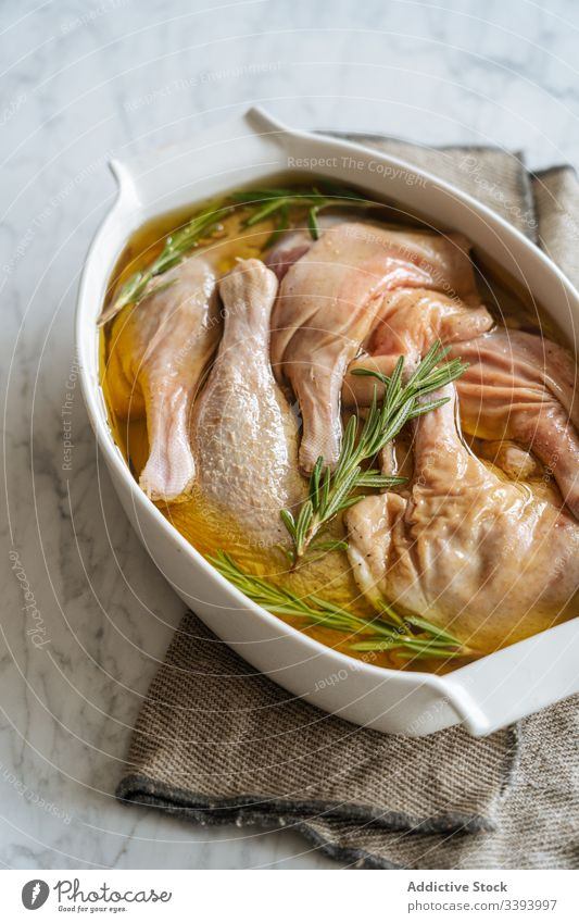 Uncooked marinated chicken legs in baking dish recipe bake food cooking raw ingredient kitchen meal dinner lunch preparation fresh cuisine culinary gastronomy