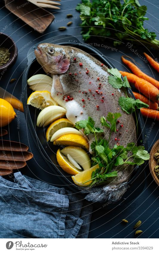 Raw fish with lemon and herbs dinner kitchen fresh seasoning parsley onion raw cook dish food preparation home carrot meal ingredient culinary cuisine organic