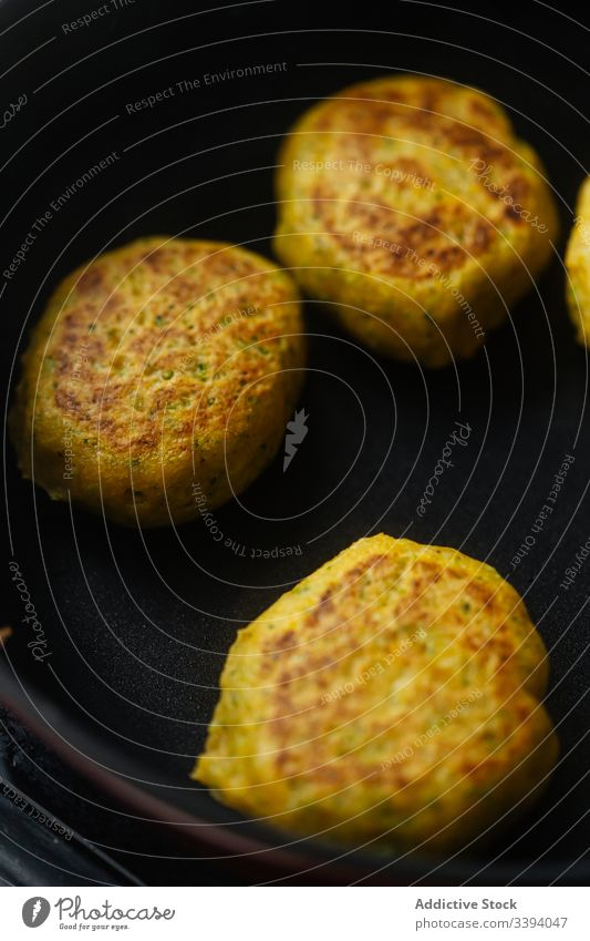 Appetizing vegetable cutlets frying in pan on stove traditional grill meal food cuisine recipe roast snack dish rustic cooking delicious herb roasted homemade