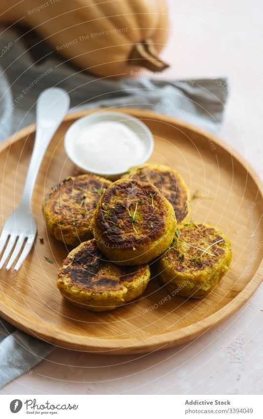 Delicious vegetable cutlets with sour cream on table pumpkin traditional fried golden roasted cuisine dish delicious gourmet plate meal food recipe snack rustic