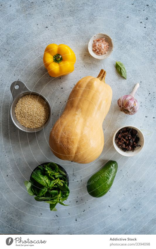 Ingredients for vegan recipe with butternut squash ingredient vegetarian food cooking pumpkin vegetable healthy grain avocado pepper garlic leaves spices