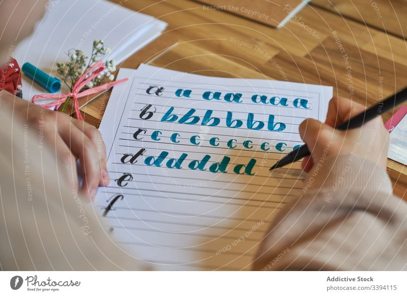 Faceless lady encircling letters with brush lettering learn draw handwriting artwork paper creative inspiration text create hobby paint design skill lifestyle