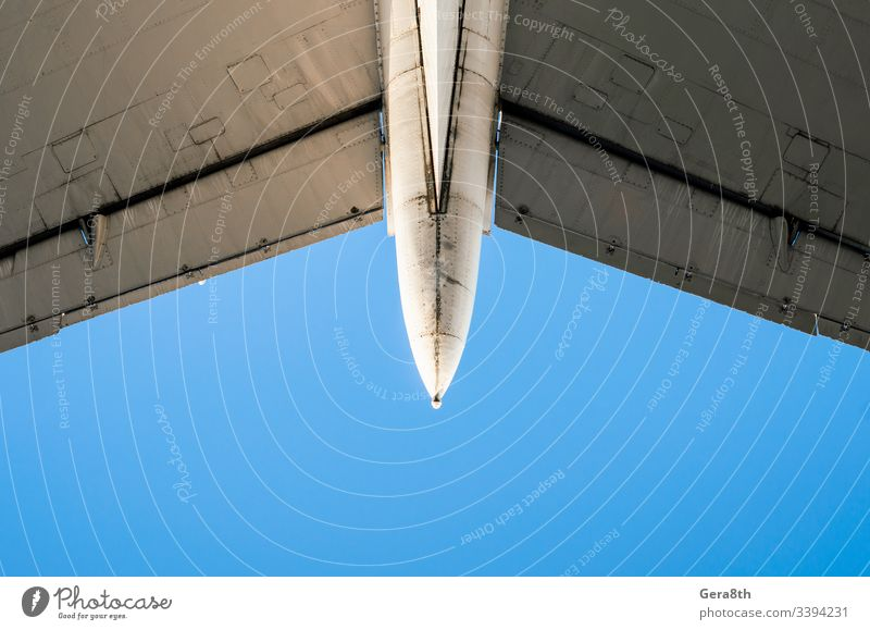 fragment of airplane wings on a background of blue sky air transport aviation color detailed engineering flight fly iron isolated mechanism metal old part speed
