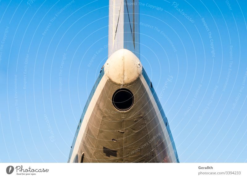 fragment of the plane of an old airliner against a blue sky air transport airplane aviation background color detailed engineering flight fly iron isolated
