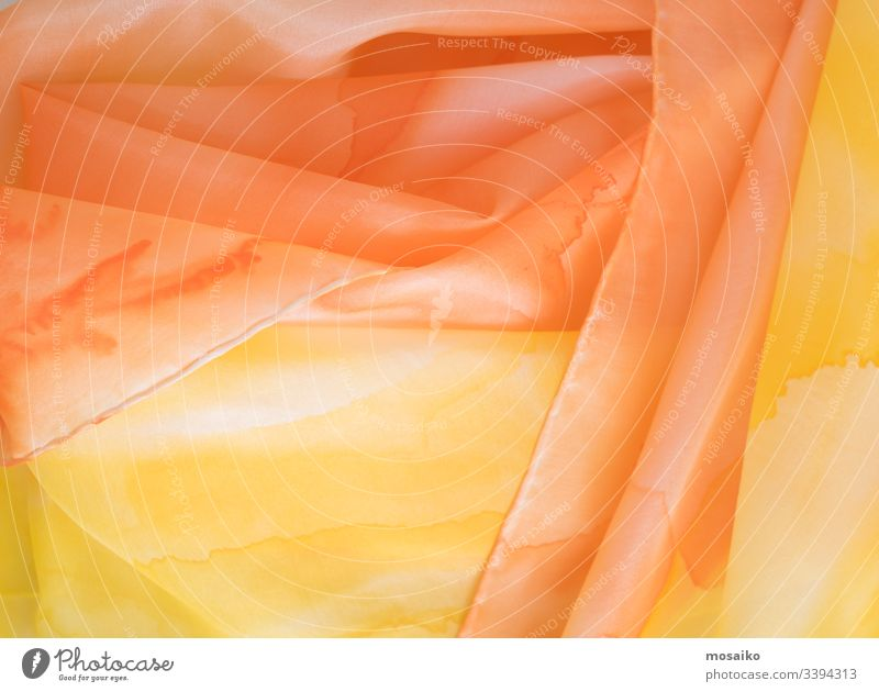 close up of hand colored orange and yellow silk scarf pongé watercolor waldorf acrylic aquarelle art artistic textile fabric silk painting background border