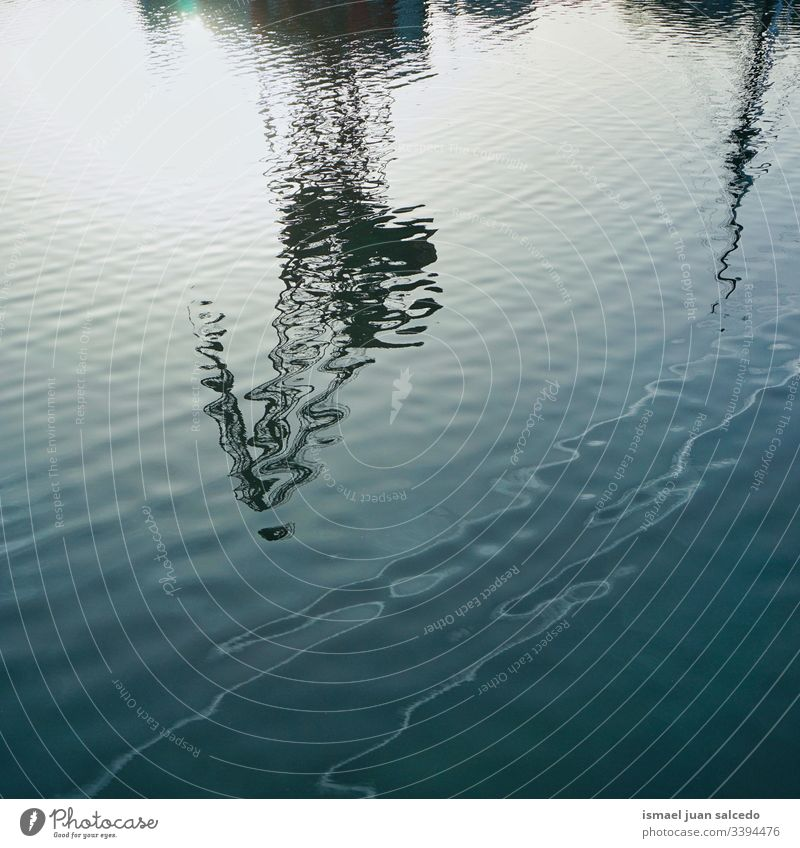 reflection on the water in the river in Bilbao city Spain light bright pool swimming pool liquid sunlight blue abstract texture background pattern ripple wave
