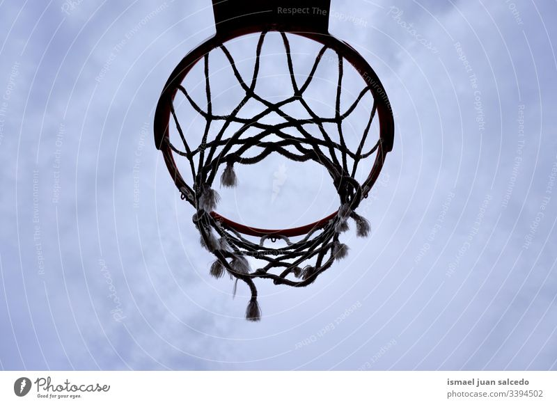 basketball hoop silhouette, street basket in Bilbao city Spain sky blue circle chain metallic net sport sports equipment play playing playful old park