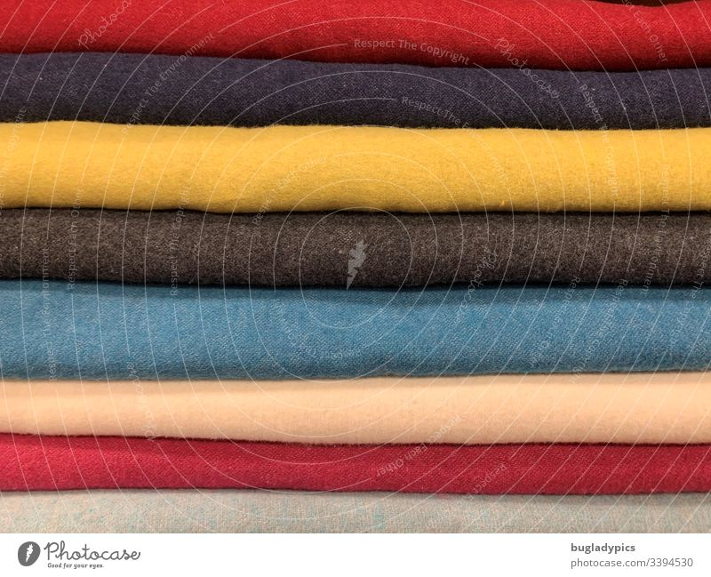 Different single-coloured fabrics (yellow, blue, red, beige, grey) placed on top of each other Cloth Wool Woollen goods motley Multicoloured variegated Close-up
