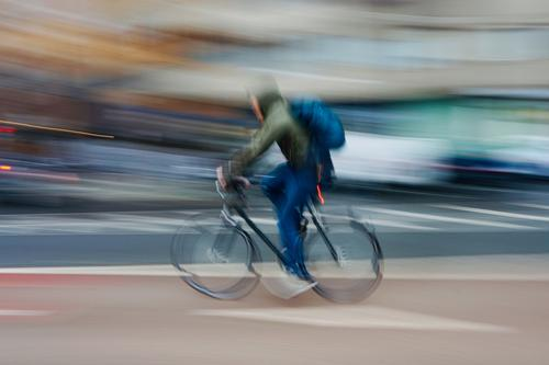 man ciclyng, bicycle mode of transport on the street in Bilbao city Spain bike transportation cycling cyclist biking biker exercise ride speed fast blur blurred