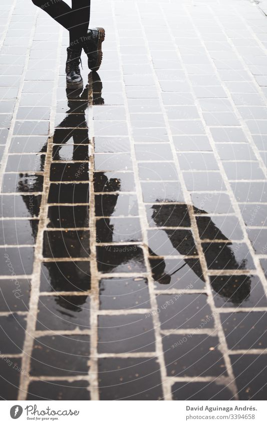 reflection of a young woman with an umbrella in a puddle after the rain Woman happy nostalgic Moody Wet Reflection Puddle Umbrella Water Rain Exterior shot
