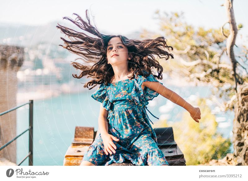 Funny little girl moving her long hair activity adorable arms wide open beautiful beauty caucasian chic child childhood clothes coast cute energy face