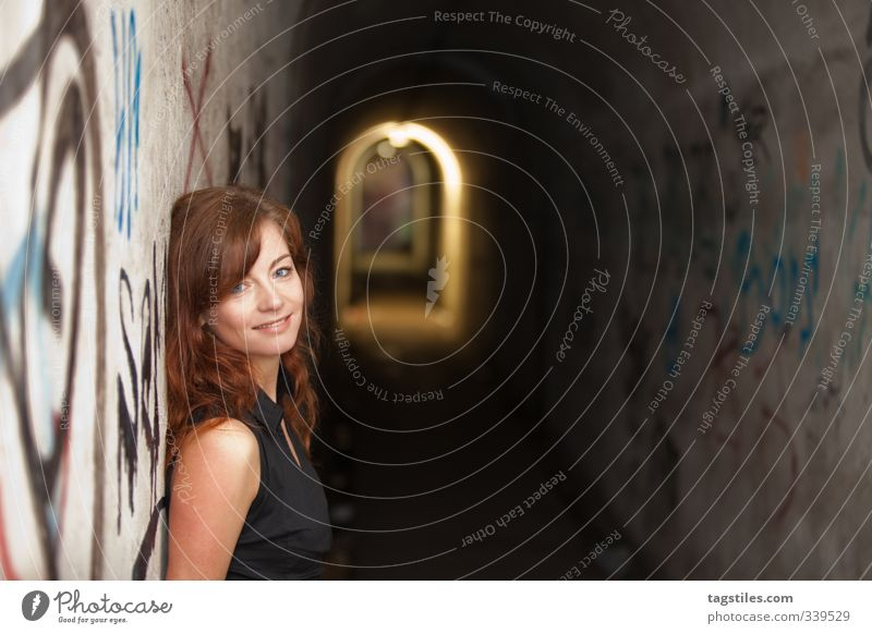 warm Warmth Woman Tunnel Warm-heartedness Red-haired Young woman Eroticism Attractive Trust Lean Graffiti Intimacy Affection Corridor Emergency exit
