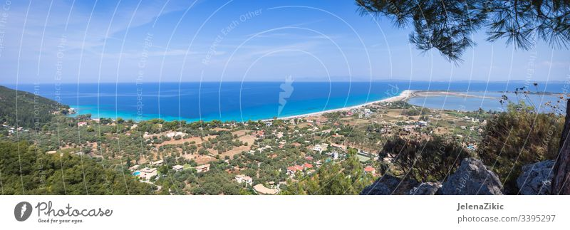 Agios Ioannis beach on Lefkada island landscape blue outdoor seascape nature clear beautiful sky scenic panorama background summer ocean horizon stones wave